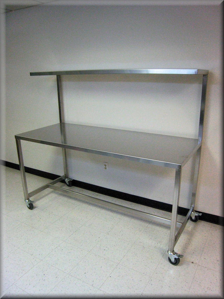 rdm - stainless steel table with upper shelf model f103p-ss