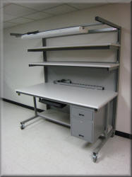 Tall Computer Table with Two Upper Shelves, Overhead Light Boom, Power Outlet Strip, Keyboard Tray, Utility / File Drawers and Casters
