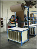 Packaging Table with Large Overhead Roll Holder & Lower Storage Cabinet